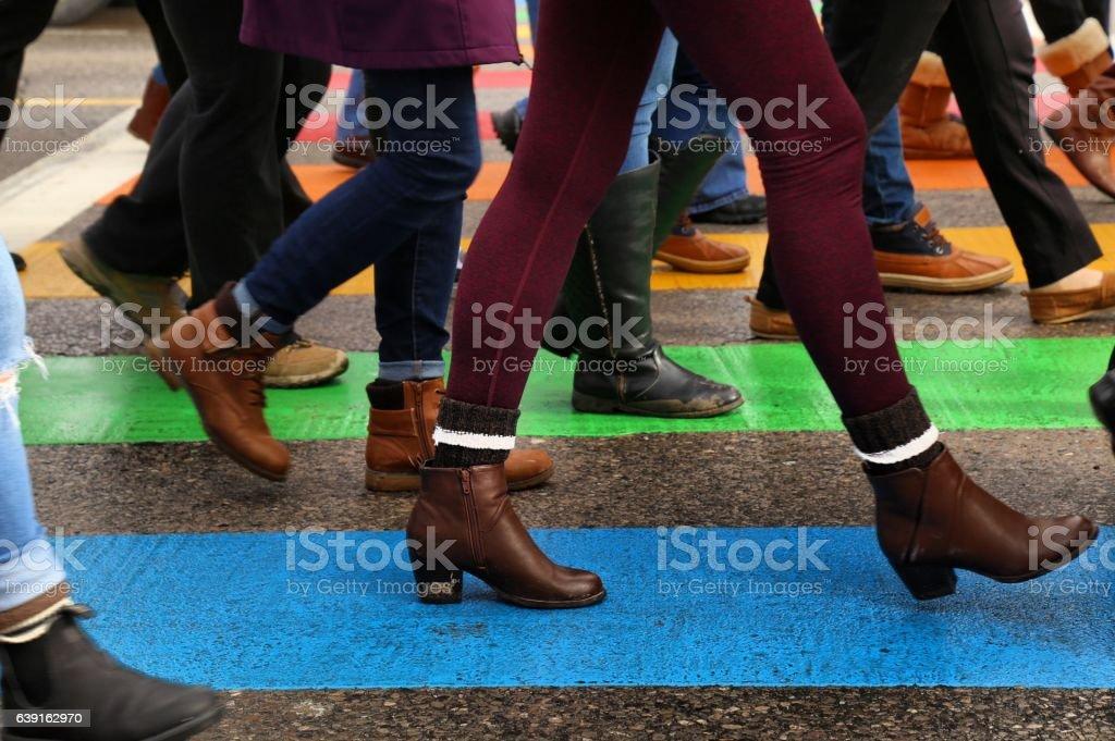 Marching on crosswalk stock photo