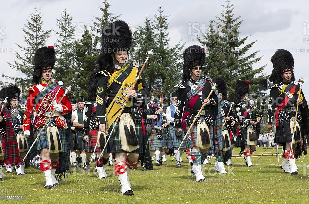Marching pipe bands at Highland Games stock photo