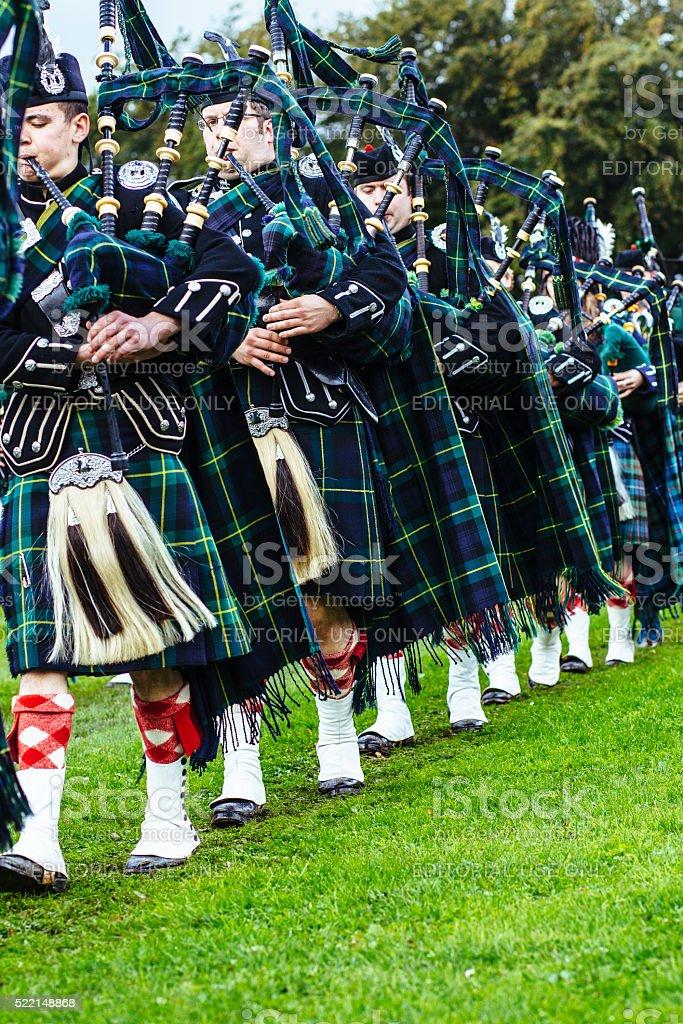 Marching Scottish pipe band stock photo