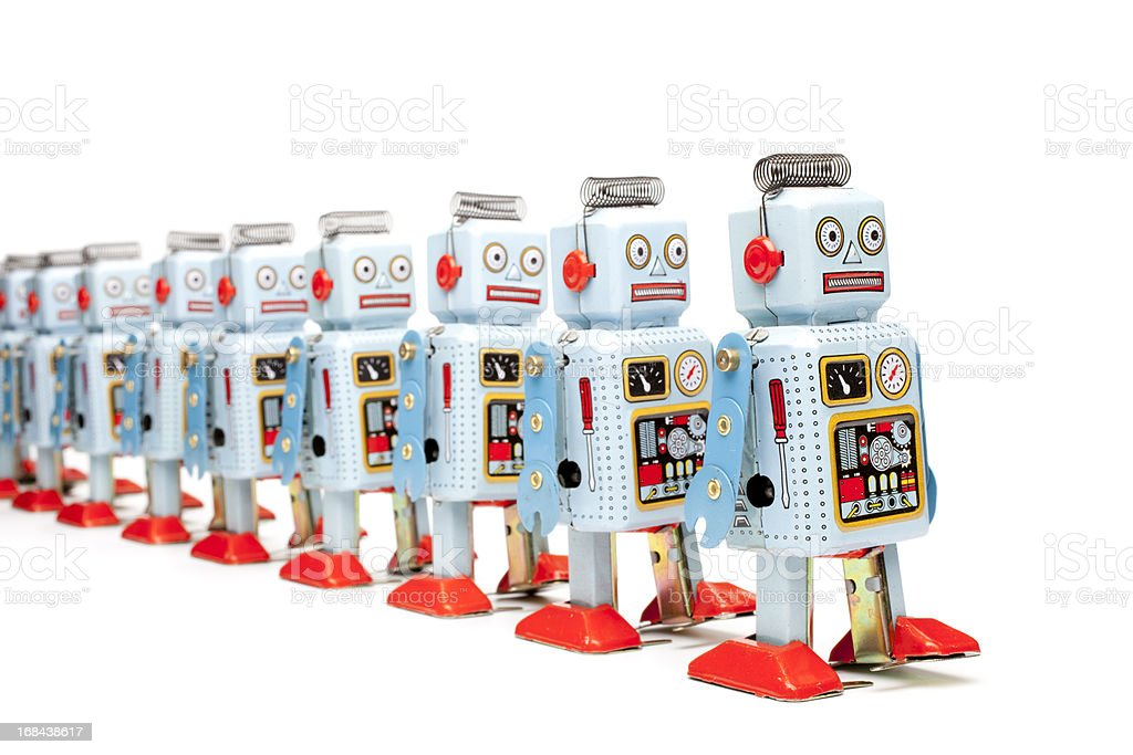 Marching tin toy robots royalty-free stock photo