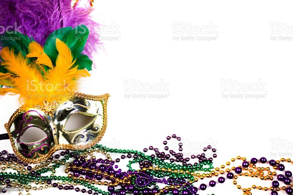 Mardi Gras background.  Purple, gold, green, mask, beads. stock photo