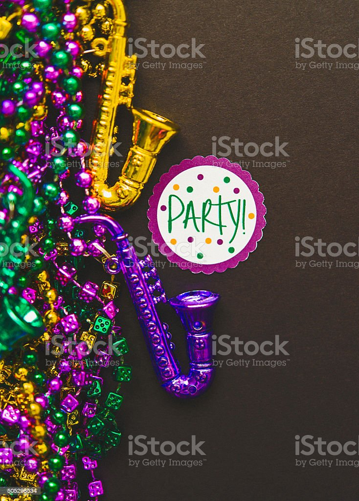 Mardi Gras background with assorted novelty bead necklaces and message stock photo