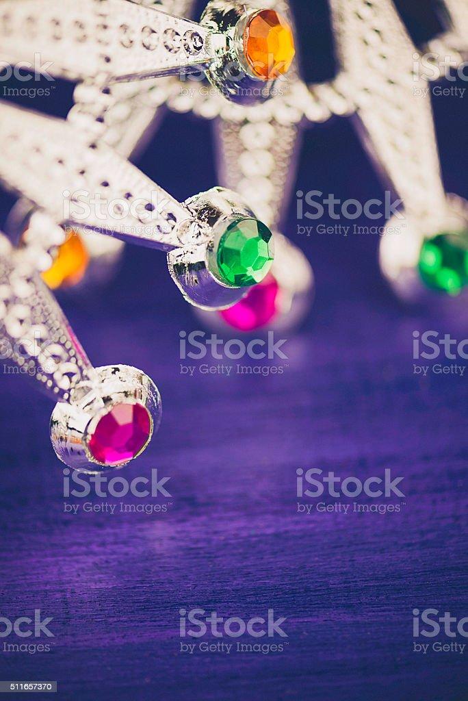 Mardi Gras background with novelty silver tiaras stock photo