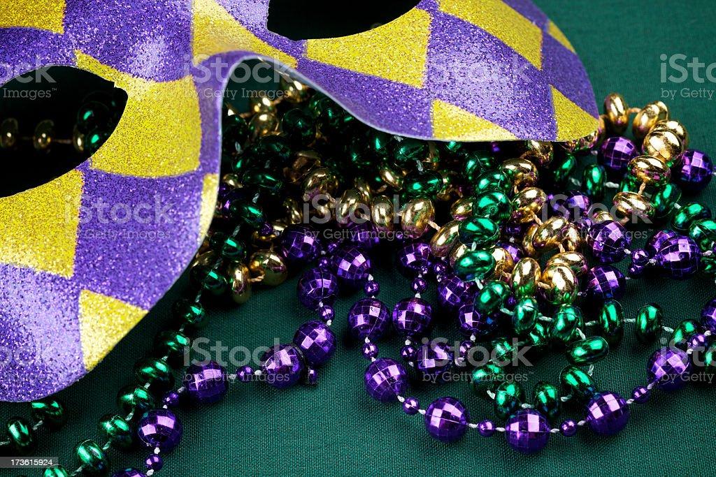 Mardi Gras beads and mask stock photo