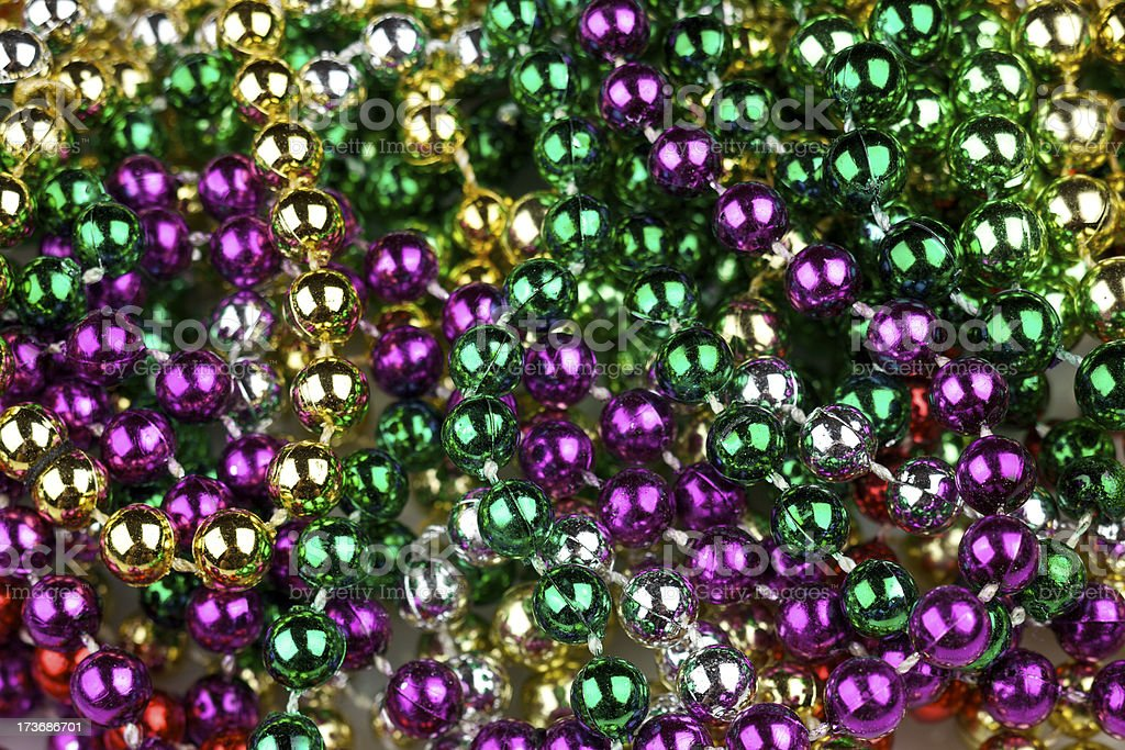 Mardi Gras beads in traditional colors stock photo