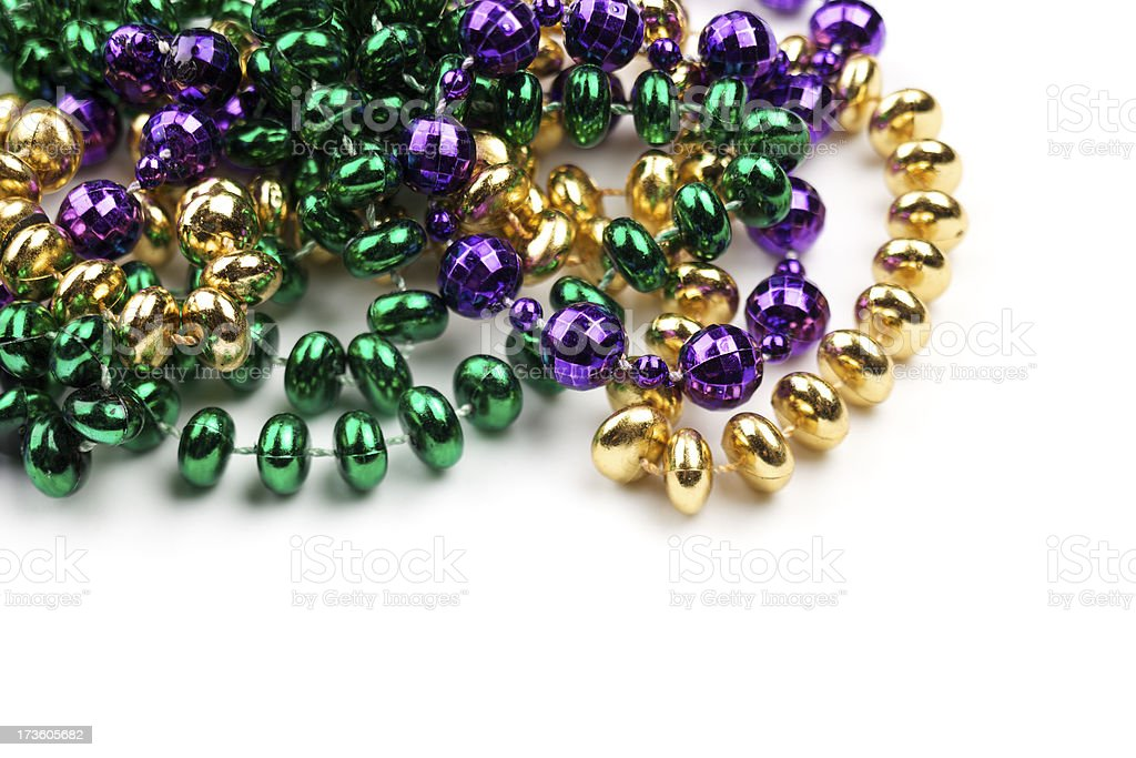 Mardi Gras beads isolated on white stock photo