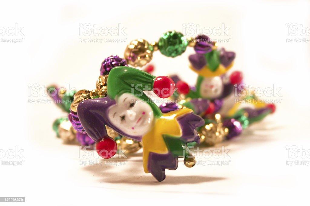 Mardi Gras Beads - joker royalty-free stock photo