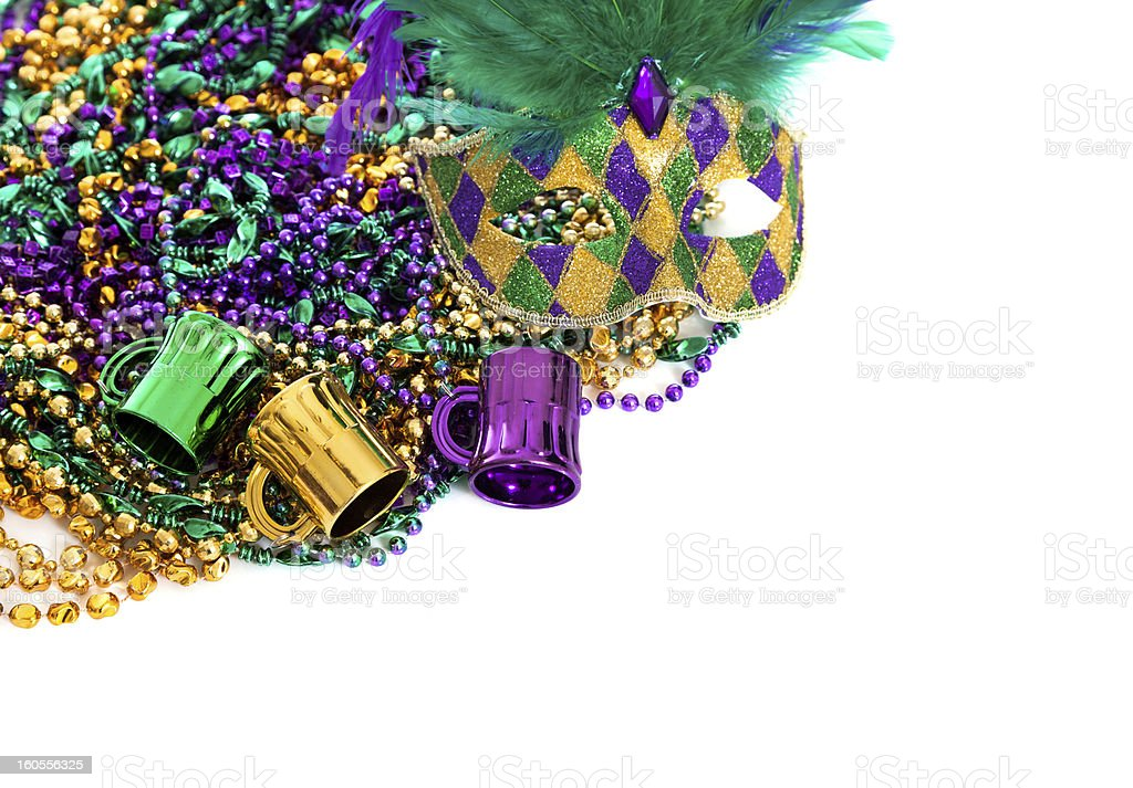 Mardi gras beads on a white background with copy space stock photo