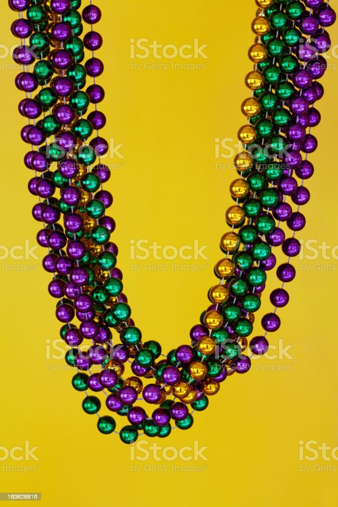 Mardi Gras Beads on Yellow stock photo