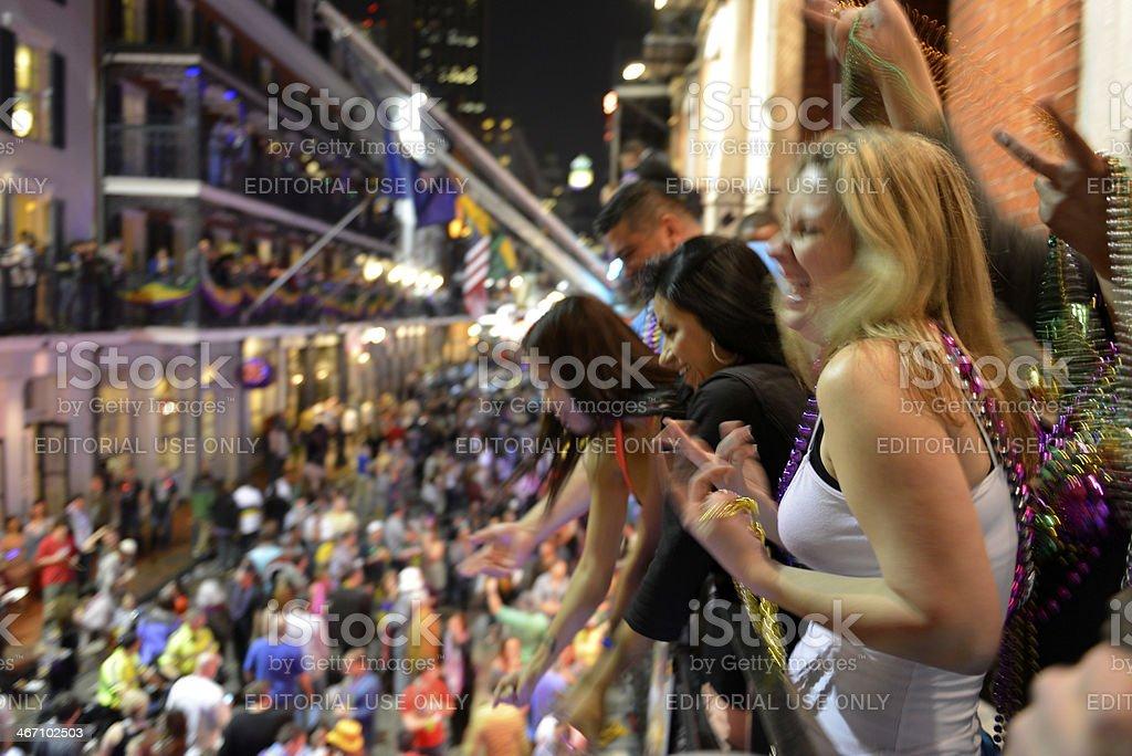 Mardi Gras celebrations on balcony and street stock photo
