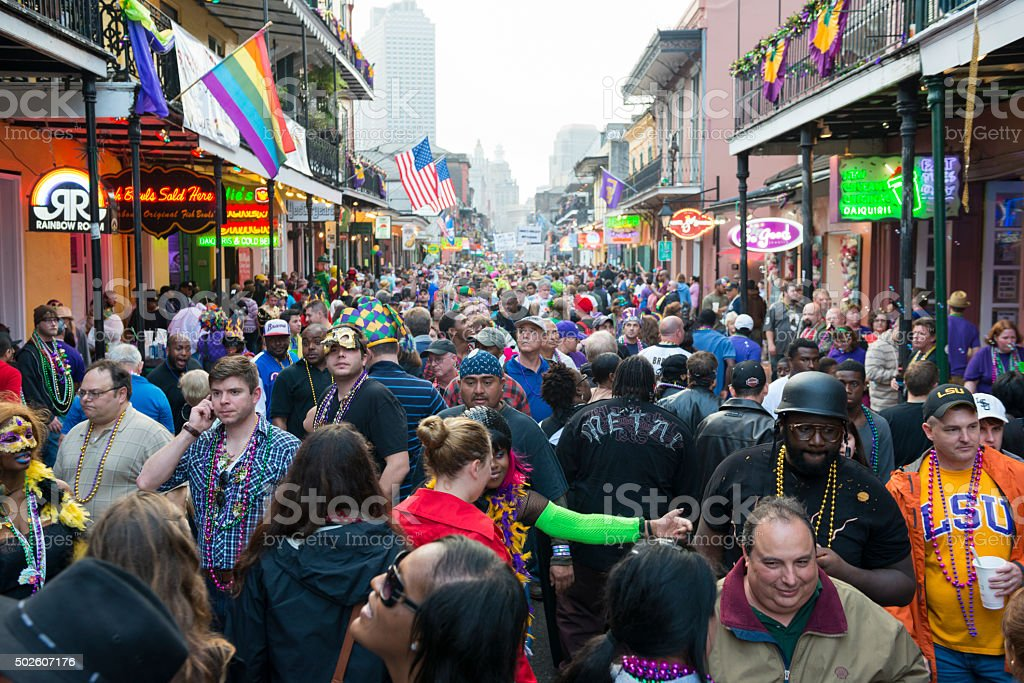 Mardi Gras crowd on Bourbon Street in New Orleans stock photo