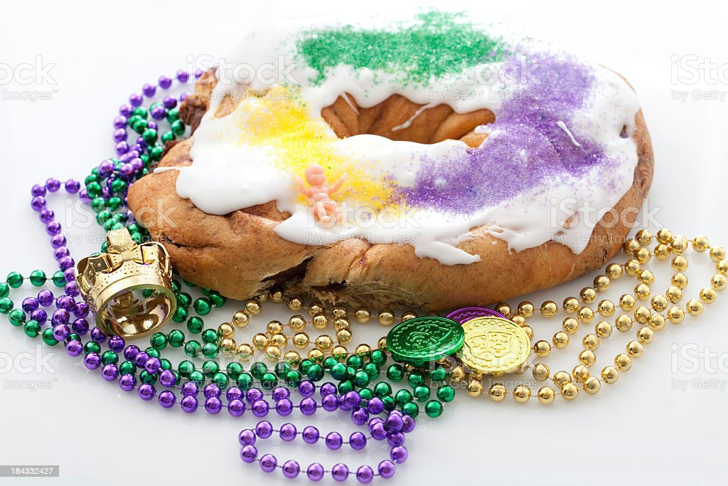 Mardi Gras king cake with beads  stock photo