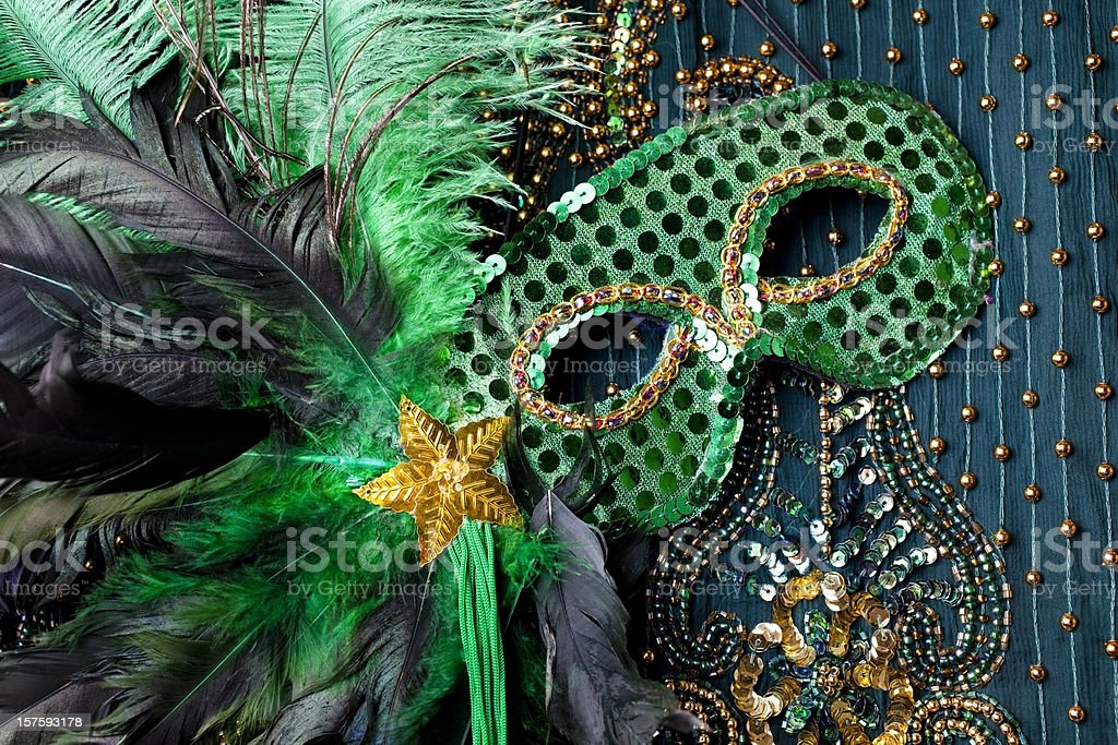 Mardi Gras mask on beaded green background. stock photo