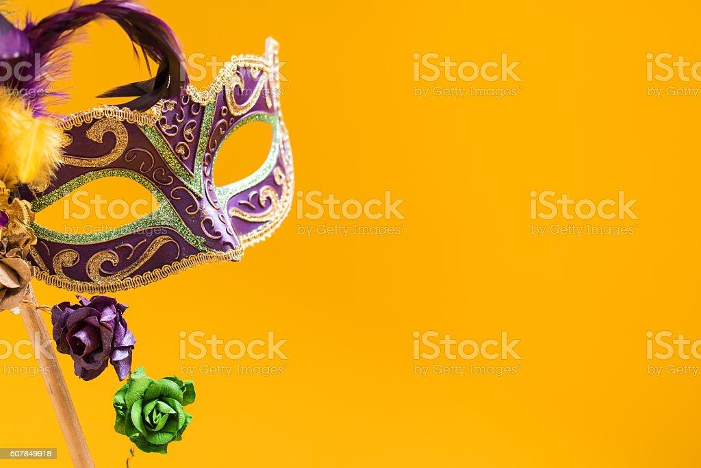 Mardi Gras Mask on yellow Background stock photo