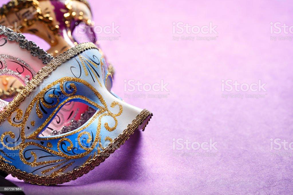 Mardi Gras Masks On A Purple Background stock photo