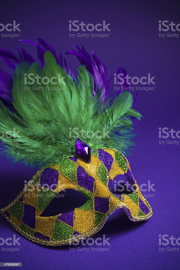 Mardi Gras or Carnivale mask on a purple background stock photo