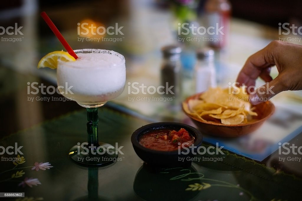 Margarita and corn chips in anticipation in a Mexican restaurant stock photo