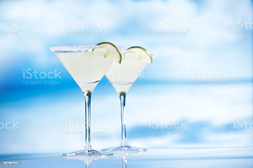 margarita cocktail on beach with seascape background stock photo