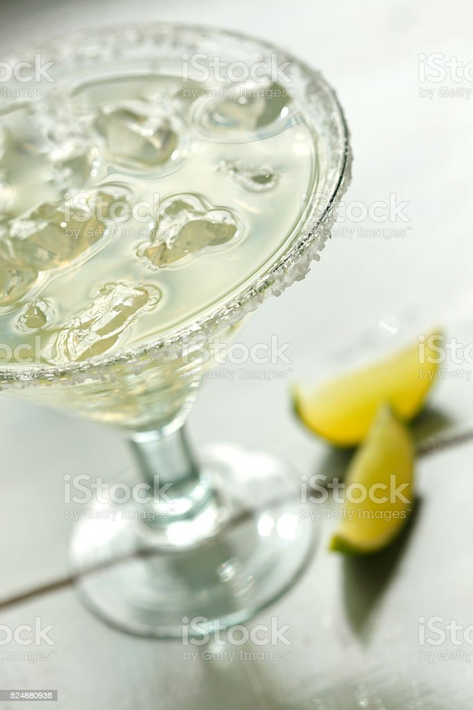 Margarita On The Rocks Next To Two Wedges Of Limes stock photo