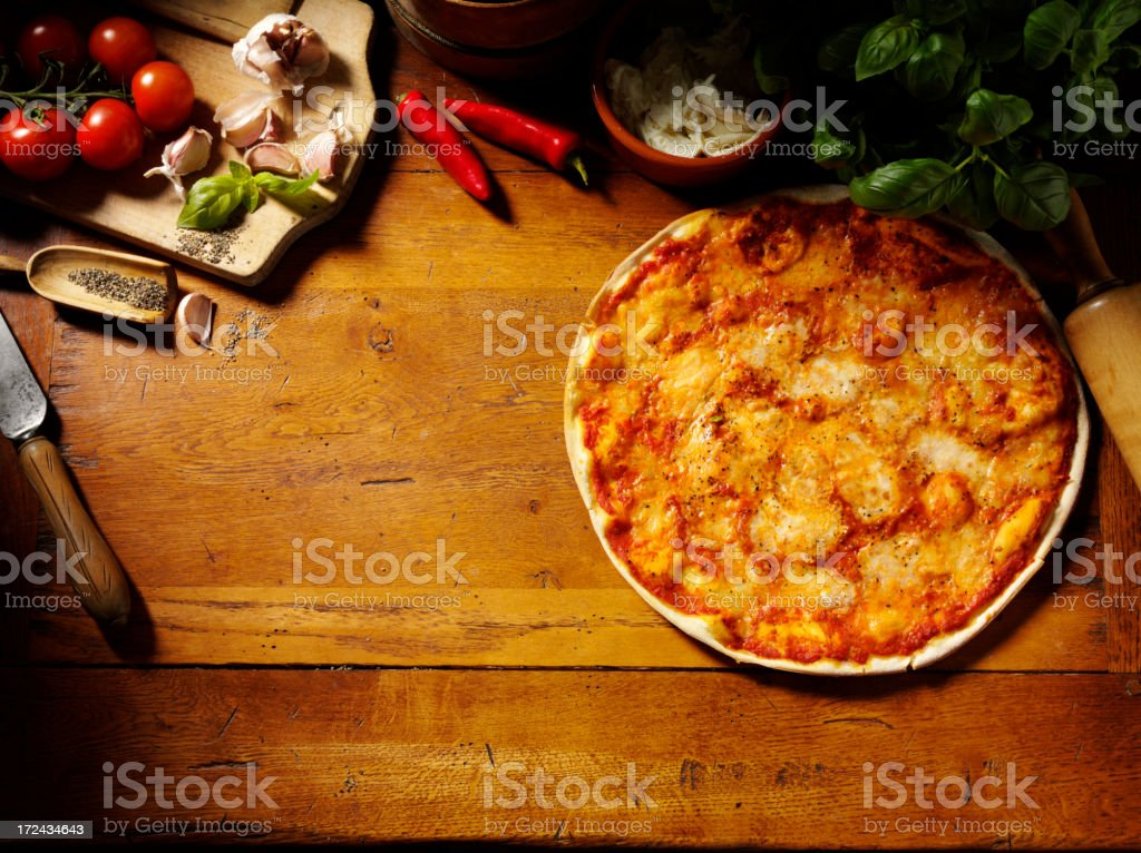 Margarita Pizza on a Wooden Table royalty-free stock photo