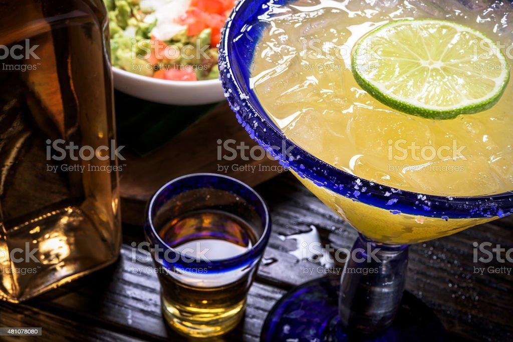 Margarita, Tequila shot, and Guacamole stock photo