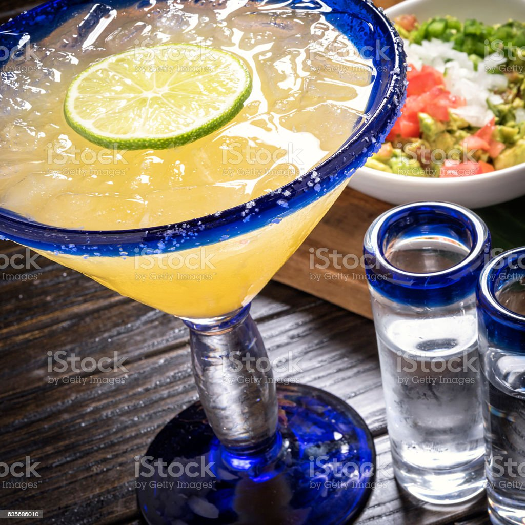 Margarita, Tequila shots, and Guacamole stock photo