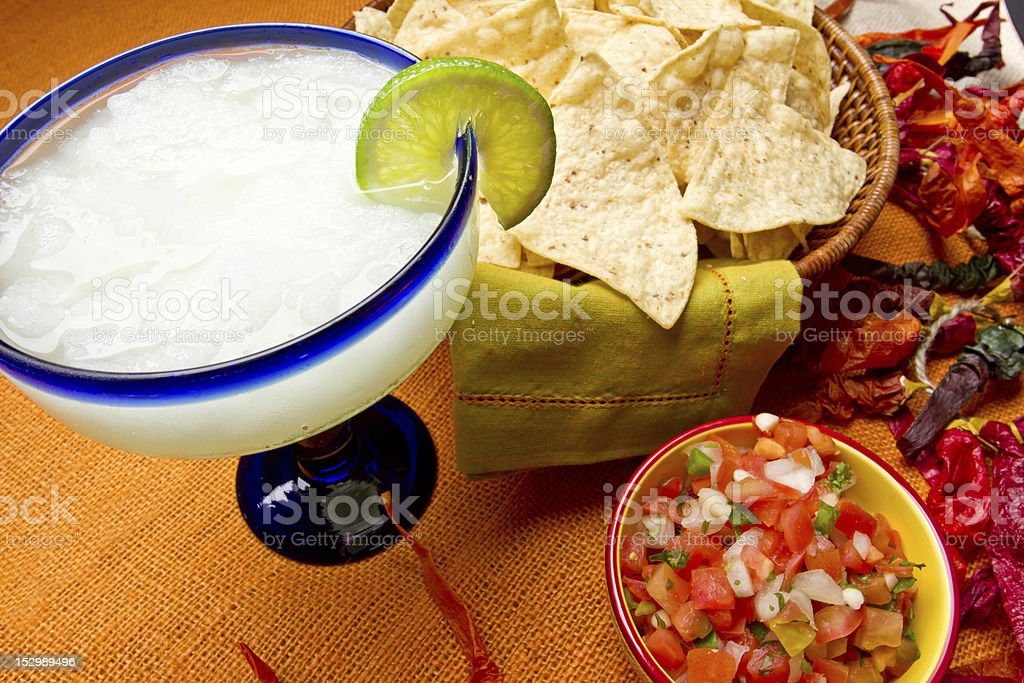 Margarita with lime and chips with salsa stock photo