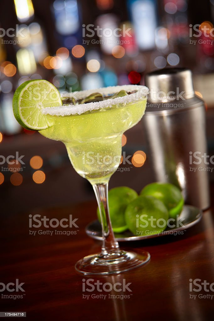 Margarita with salted rim and bokeh bar background stock photo