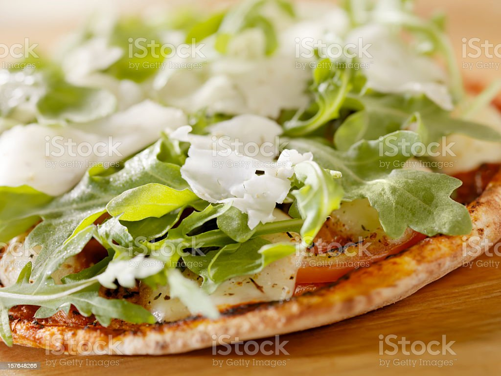 Margharita Pizza with Arugula on Flat Bread royalty-free stock photo