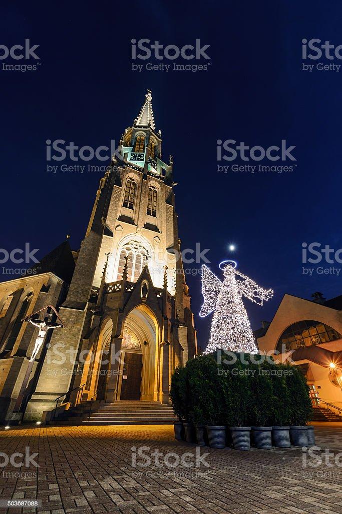 Mariacki church with angel in christmas night. Katowice stock photo