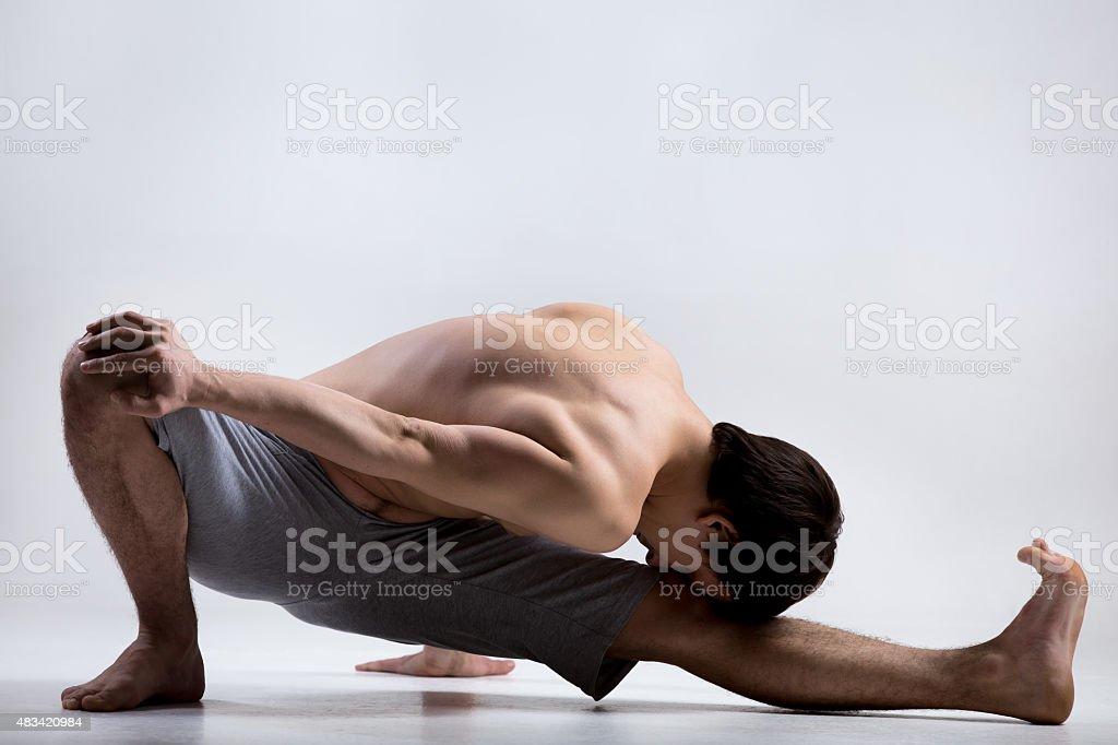 Marichyasana I yoga Pose stock photo
