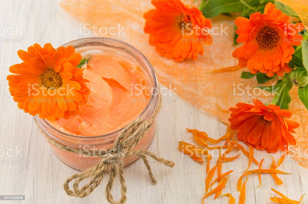 marigold cream with a fresh flower bouquet stock photo