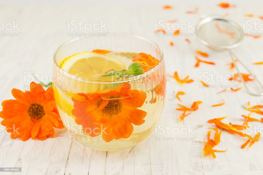 marigold flower herbal tea with lemon slices stock photo