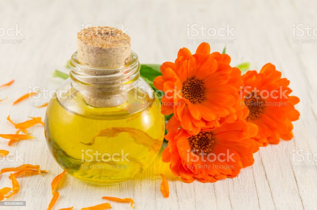 marigold oil with a fresh flower bouquet stock photo