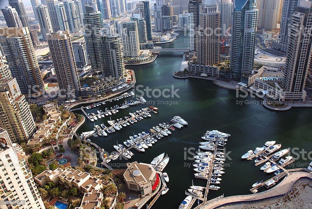 marina overhead shot with high rises and watercraft stock photo