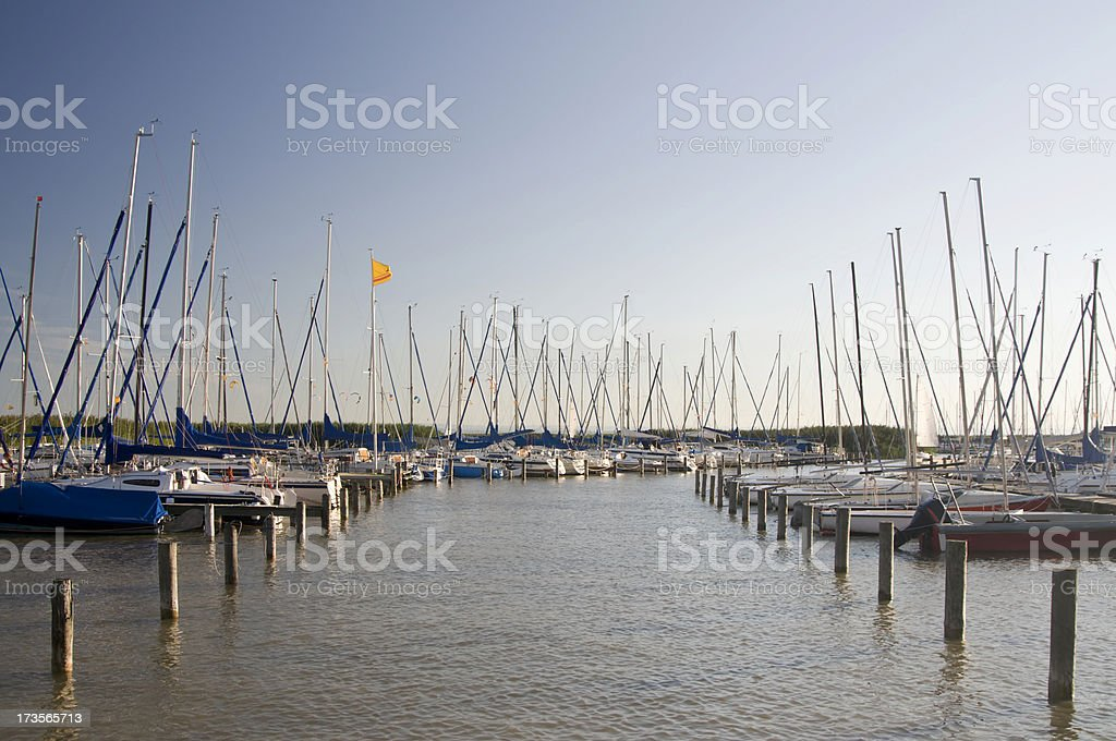 Marina with Kitesurfers in Background royalty-free stock photo