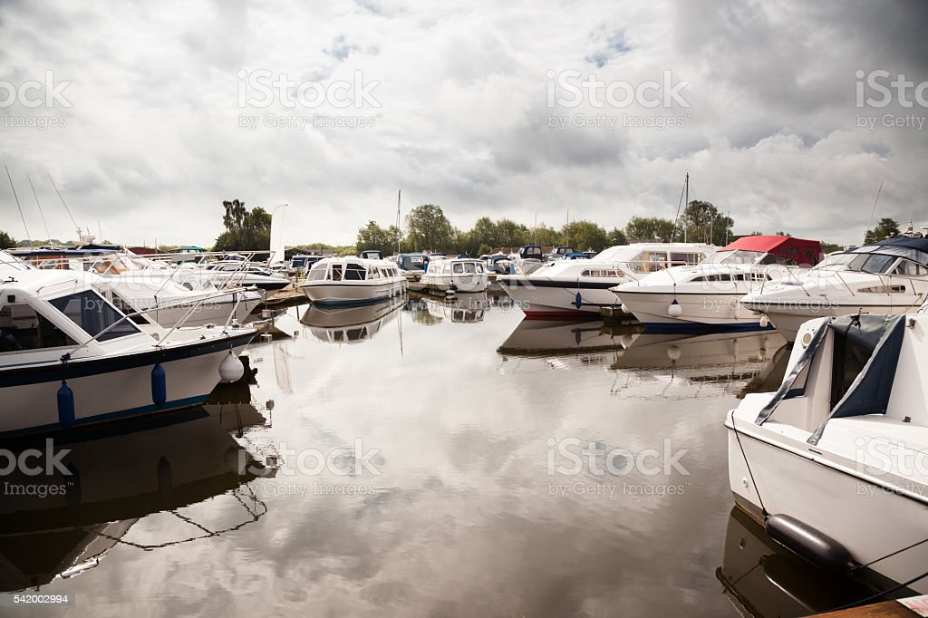 marina with moored yachts and motor boats  on Norfolk broads stock photo
