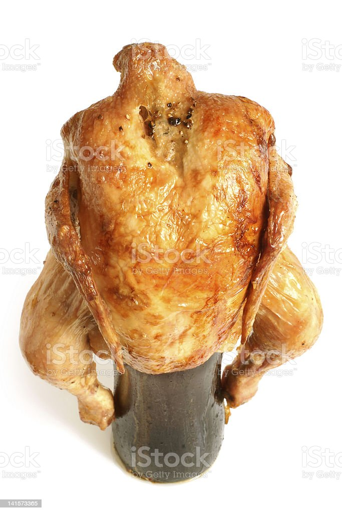 Marinated and roasted chicken on a beer bottle royalty-free stock photo