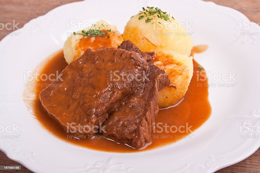 Marinated beef served with potato dumplings stock photo