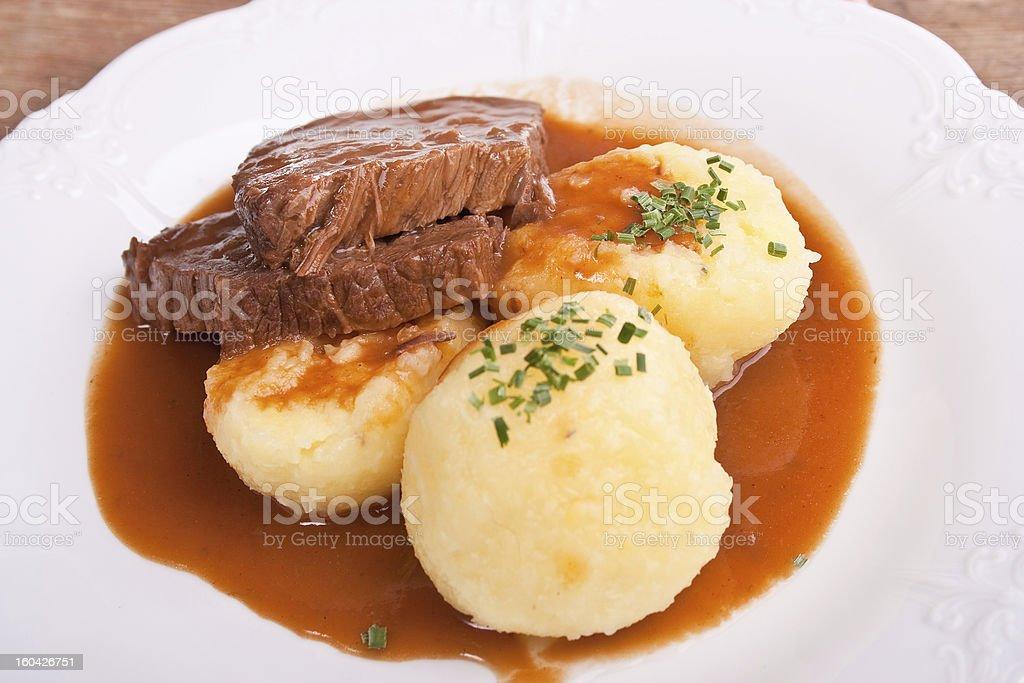 marinated beef with potato dumplings stock photo