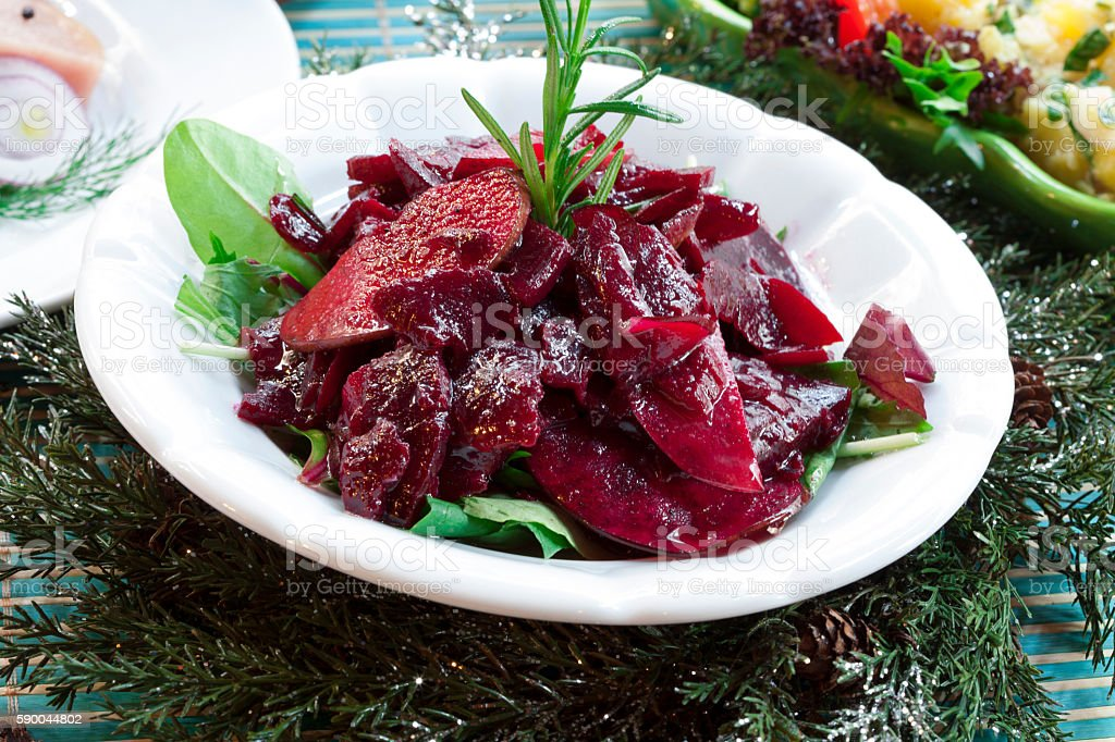 Marinated Beet Salad with green vegetables stock photo