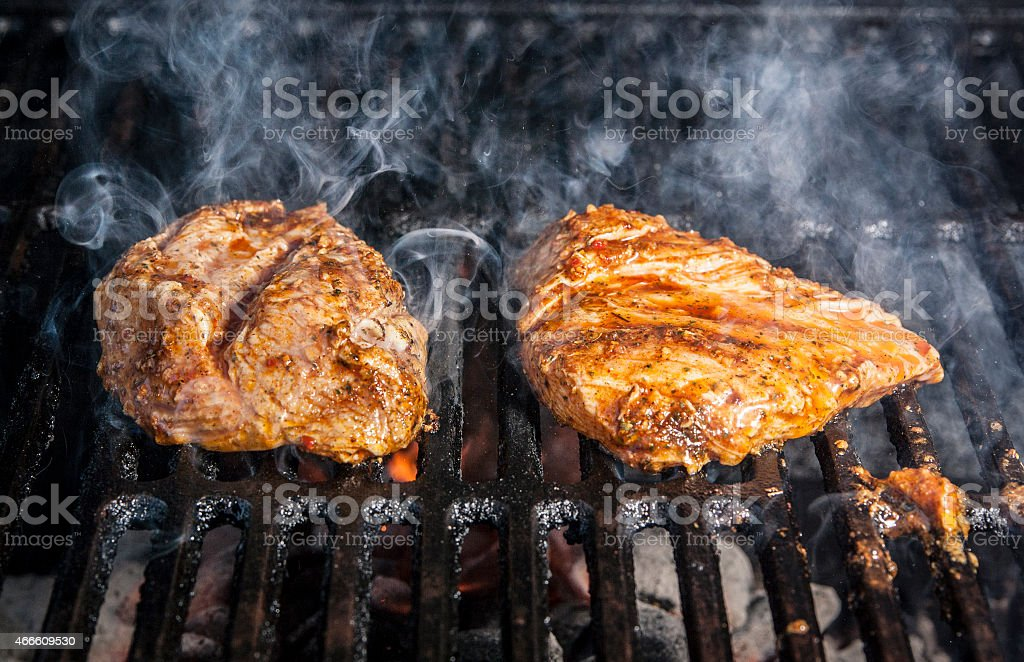 Marinated Chicken on Grill stock photo