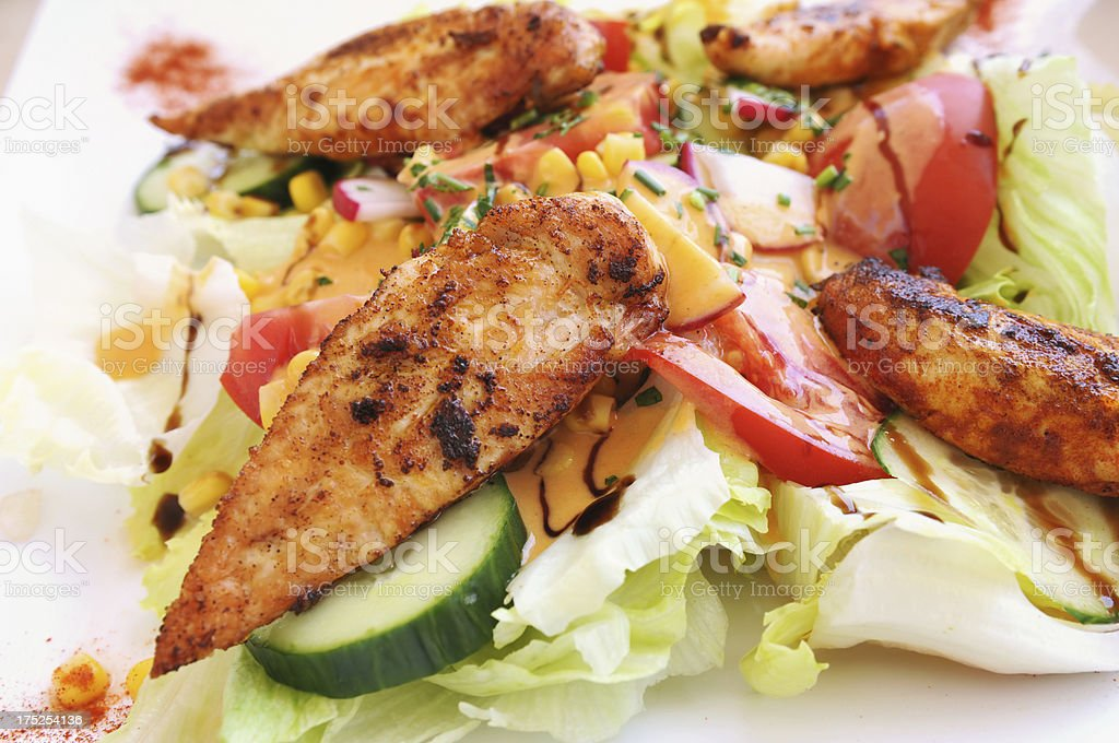 Marinated chicken steak with fresh salad stock photo