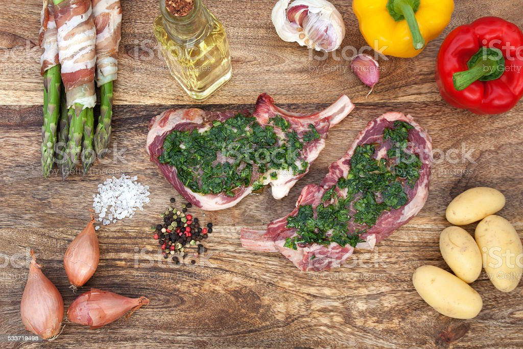 Marinated cutlet with ingredients for grilling stock photo