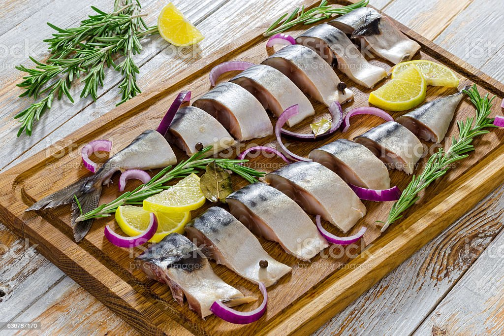 marinated Fillets of Fresh atlantic mackerel fish cut in slices stock photo