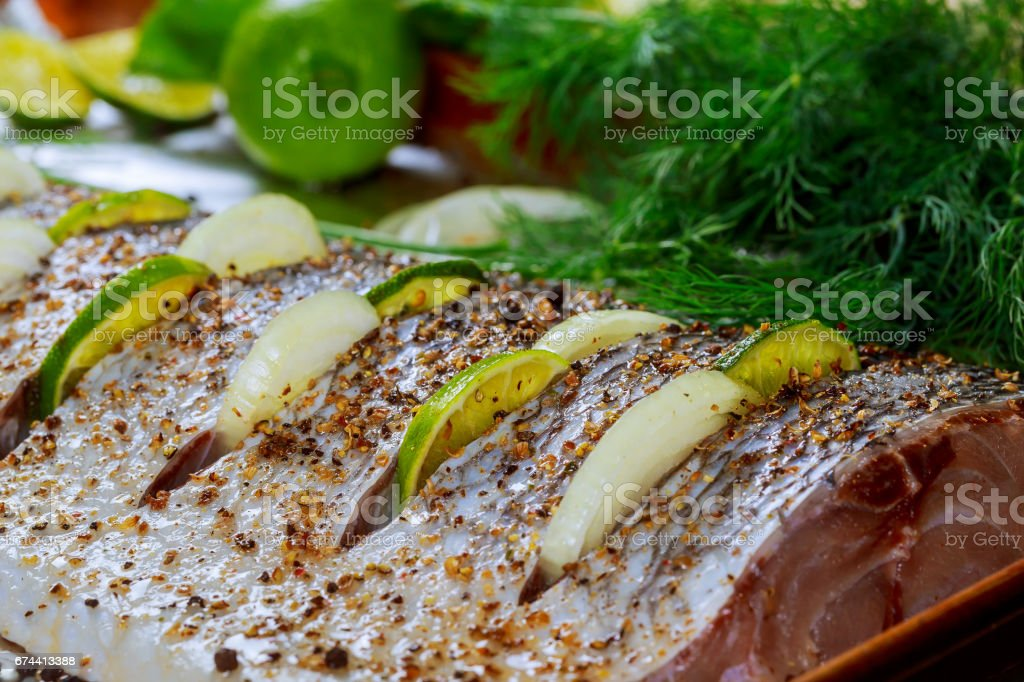 marinated fish with lemon and onion stock photo