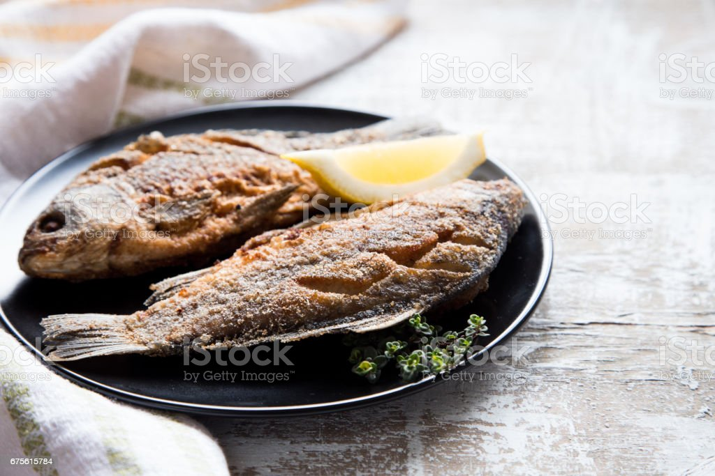 Marinated fried fish carp. Spicy fish fry with spices stock photo