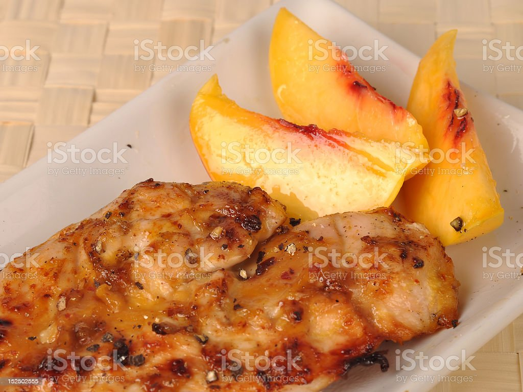 Marinated grilled chicken with apricot stock photo
