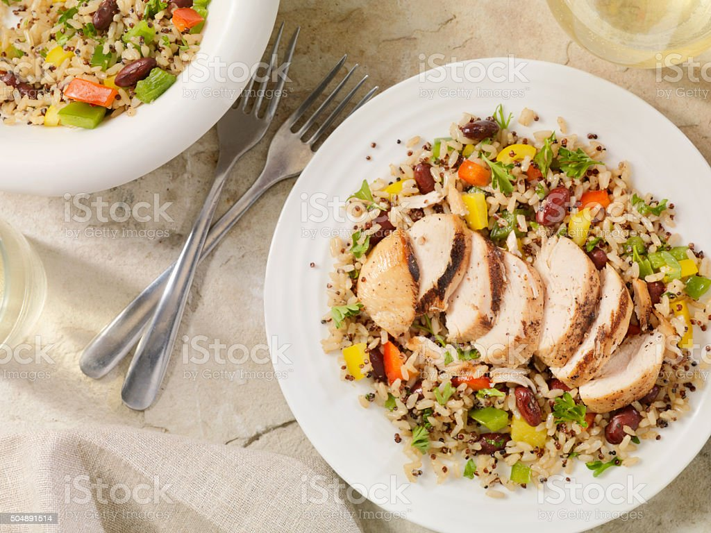Marinated Grilled Chicken with Quinoa and Brown Rice Salad stock photo