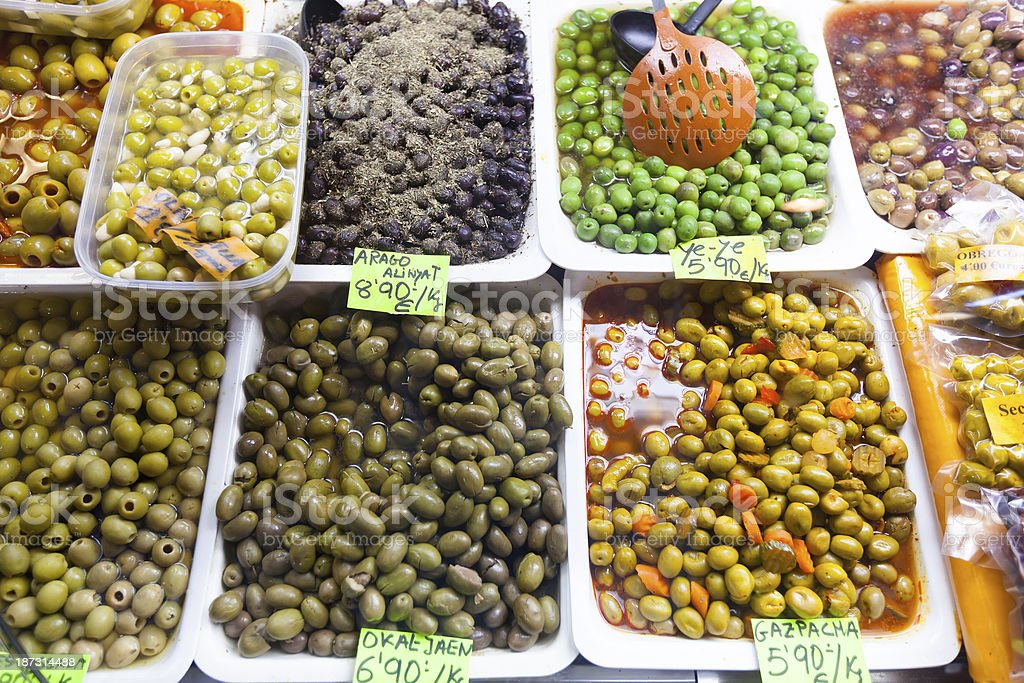marinated olives in cans at  market stock photo